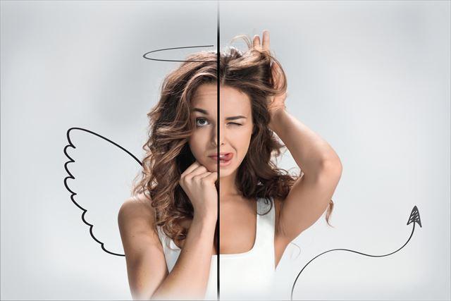 天使と悪魔の気持ちで迷う女性の画像
